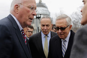 Senate Judiciary Committee ranking member Sen. Patrick Leahy (D-VT) (L), Sen. Charles Schumer (D-NY) (C) and Minority Leader Harry Reid (D-NV) arrive outside the Supreme Court before holding a news conference where he demanded that Senate Republicans hold confirmation hearings when President Barack Obama names a new Supreme Court justice nominee February 25, 2016 in Washington, DC. GOP leaders in the Senate said they would not hold a confirmation hearing after Obama said he would name someone to replace Associate Justice Antonin Scalia, who died earlier this month while on a hunting trip in Texas.