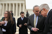 Senate Minority Leader Harry Reid (D-NV) (R) talks with Sen. Charles Schumer (D-NY) outside the Supreme Court following a news conference where they and other Democrats demanded that Senate Republicans hold confirmation hearings when President Barack Obama names a new Supreme Court justice nominee February 25, 2016 in Washington, DC. GOP leaders in the Senate said they would not hold a confirmation hearing after Obama said he would name someone to replace Associate Justice Antonin Scalia, who died earlier this month while on a hunting trip in Texas.