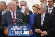 Senate Judiciary Committee ranking member Sen. Patrick Leahy (D-VT) holds a pocket-sized copy of the U.S. Constitution while joining Minority Leader Harry Reid (D-NV) and other Democrats in front of the Supreme Court for a news conference and to demand that Senate Republicans hold confirmation hearings when President Barack Obama names a new Supreme Court justice nominee February 25, 2016 in Washington, DC. GOP leaders in the Senate said they would not hold a confirmation hearing after Obama said he would name someone to replace Associate Justice Antonin Scalia, who died earlier this month while on a hunting trip in Texas.