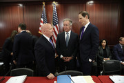 Rep. Kevin Brady (L) (R-TX), chairman of the House Ways and Means Committee, speaks with Sen. Ron Wyden (R) (D-OR) and Rep. Richard Neal (C) (D-MA) as members of the U.S. Senate and U.S. House of Representatives gather for a Senate-House Conference Committee meeting December 13, 2017 at the U.S. Capitol in Washington, DC.  The Senate-House Conference Committee met to review and reconcile tax reform legislation passed by both houses of the U.S. Congress.