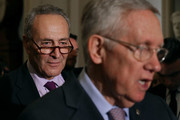 Sen. Charles Schumer (D-NY) listens to Senate Minority Leader Harry Reid (D-NV) talk to reporters following the weekly Senate Democratic policy luncheon at the U.S. Capitol September 13, 2016 in Washington, DC. Reid  repeated the Democrats' call on the Senate Republicans in the majority to allow a vote for funding to fight against the Zika virus and to pass a federal budget continuing resolution.
