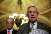 U.S. Senate Minority Leader Harry Reid (D-NV) (R) speaks as Sen. Charles Schumer (D-NY) (L) listens after the Democratic weekly policy luncheon January 20, 2016 on Capitol Hill in Washington, DC. Senate Democrats held its weekly luncheon meeting to discuss Democratic agenda.