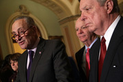 U.S. Senate Minority Leader Sen. Chuck Schumer (D-NY) (2nd L) speaks as Senate Minority Whip Sen. Dick Durbin (D-IL) (R), Sen. Ben Cardin (D-MD) (3rd L), and Sen. Amy Klobuchar (D-MN) (L) listen during a news briefing after a weekly Senate Democratic Policy Luncheon at the Capitol November 28, 2017 in Washington, DC. Schumer and House Minority Leader Rep. Nancy Pelosi (D-CA) canceled a scheduled meeting with President Trump after the president saying that there won't be a deal with the Democrats to avert a government shutdown via a tweet.