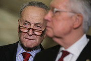 Sen. Charles Schumer (D-NY) (L) and Senate Minority Leader Harry Reid (D-NV) talk with reporters following the weekly Democratic Senate policy luncheon at the U.S. Capitol April 26, 2016 in Washington, DC. Republicans and Democrats in the Senate are at odds about how much money the federal government should spend on preparation and prevention of the spread of the Zika virus once it arrives in the United States this summer.