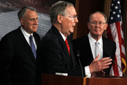 U.S. Senate Minority Leader Sen. Mitch McConnell (R-KY) (C) speaks as Senate Minority Whip Sen. Jon Kyl (R-AZ) (L), and Sen. Lamar Alexander (R-TN) (R) listen during a news conference July 12, 2011 on Capitol Hill in Washington, DC. McConnell discussed the ongoing budget and debit limit negotiations with the administration and proposed a new solution for the administration to raise the debt  ceiling.