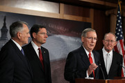 U.S. Senate Minority Leader Sen. Mitch McConnell (R-KY) (3rd L) speaks as (L-R) Senate Minority Whip Sen. Jon Kyl (R-AZ), Sen. John Barrasso (R-WY), and Sen. Lamar Alexander (R-TN) listen during a news conference July 12, 2011 on Capitol Hill in Washington, DC. McConnell discussed the ongoing budget and debit limit negotiations with the administration and proposed a new solution for the administration to raise the debt  ceiling.