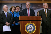 """(L-R) Sen. Ben Cardin (D-MD), Sen. Dianne Feinstein (D-CA), Sen. Chris Murphy (D-CT), Sen. Charles Schumer (D-NY) and  Senate Minority Leader Harry Reid (D-NV) hold a news conference about Democratic legislative proposals in the wake of last week's terror attacks in Paris at the U.S. Capitol November 19, 2015 in Washington, DC. Senate Democrats proposed tightening the visa waiver program, requiring more biometric information and e-chip passports from overseas travelers visiting the United States and closing a loophole that allows people on the Terrorist Screening Center's No Fly List to purchase firearms or explosives. """"If you are too dangerous to board a plane then you are too dangerous to buy a gun,"""" said Feinstein."""