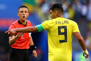 Referee Milorad Mazic speaks with Radamel Falcao of Colombia during the 2018 FIFA World Cup Russia group H match between Senegal and Colombia at Samara Arena on June 28, 2018 in Samara, Russia.