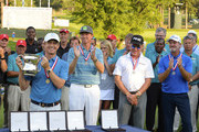 David Toms lifts the winner's trophy as Tim Patrovic, Miguel Angel Jimenez of Spain and Jerry Kelly look on during the final round of the U.S. Senior Open Championship at The Broadmoor Golf Club on July 1, 2018 in Colorado Springs, Colorado.