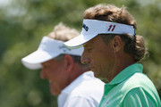 Colin Montgomerie of Scotland (L) walks alongside Bernhard Langer of Germany on the first hole during the second round of the 2013 U.S. Senior Open Championship at Omaha Country Club on July 12, 2013 in Omaha, Nebraska.