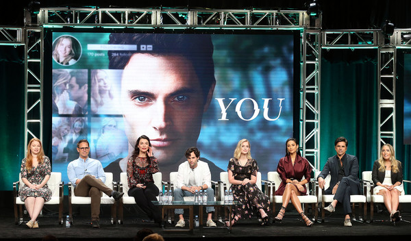 Summer 2018 TCA Press Tour - Day 2 [television show,stage,performance,musical,event,technology,heater,performing arts,display device,electronic device,performance art,greg berlanti,sarah schechter,sera gamble,caroline kepnes,john stamos,shay mitchell,l-r,tca,press tour]
