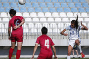 Jill Scott (R) of England scores the opening goal past Mirela Tenkov (C) and Nevena Damjanovic (L) of Serbia during the UEFA Women's European Championship Qualifier match between Serbia and England at Sports Center of FA of Serbia on June 7, 2016 in Stara Pazova, Serbia.