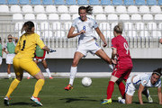 Jill Scott (C) of England in action against Marija Radojicic (R) and goalkeeper Susanne Nilsson (L) of Serbia of during the UEFA Women's European Championship Qualifier match between Serbia and England at Sports Center of FA of Serbia on June 7, 2016 in Stara Pazova, Serbia.