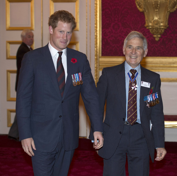 Prince Harry chats with Jim Beaton GC (former Royal Protection officer) as he hosts the President's Party in remembrance and re-dedication for members of the Victoria Cross and George Cross Association in the State Apartments at St James's Palace on October 29, 2014 in London, England.
