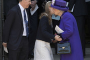 Queen Elizabeth II kisses Lady Margarita Armstrong-Jones as her father David Armstrong-Jones looks on as they leave a Service of Thanksgiving for the life and work of Lord Snowdon at Westminster Abbey on April 7, 2017 in London, United Kingdom.