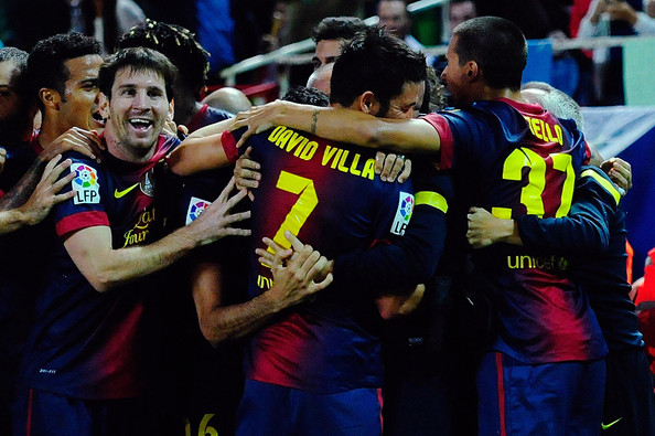 Players of FC Barcelona celebrate with David Villa and teammates Leo Messi and Cristian Tello scoring their third goal during the La Liga match between Sevilla FC and FC Barcelona at Estadio Ramon Sanchez Pizjuan on September 29, 2012 in Seville, Spain.