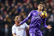 Raphael Varane of Real Madrid CF (R) competes for the ball with Samir Nasri of Sevilla FC (L) during the La Liga match between Sevilla FC and Real Madrid CF at Estadio Ramon Sanchez Pizjuan on January 15, 2017 in Seville, Spain.