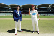 Peter Nevill (L) captain of the Blues is pictured at the coin toss with Johan Botha captain of the Redbacks who won the toss and elected to bat during day one of the Sheffield Shield match between South Australia and New South Wales at Adelaide Oval on March 3, 2014 in Adelaide, Australia.