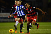 Barry Bannan of Sheffield Wednesday battles with Karl Henry of Queens Park Rangers during the Sky Bet Championship match between Sheffield Wednesday and Queens Park Rangers at Hillsborough on February 23, 2016 in Sheffield, United Kingdom.
