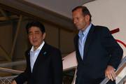 Japanese Prime Minister Shinzo Abe and Australian Prime Minister Tony Abbott walk from their aircraft after arriving at Perth airport on July 9, 2014 in Perth, Australia. Prime Minister Abe is in Australia for three days and will sign an Economic Partnership Agreement with Australia. Japan is Australia's second biggest trading partner.