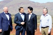 (L-R) Rio Tinto CEO Sam Walsh, Prime Minister Tony Abbott, the Prime Minister of Japan, Shinzo Abe, and WA premier Colin Barnett arrive for  a tour of the Rio Tinto West Angelas iron ore mine on July 9, 2014 in the Pilbara, West Australia. The Japanese Prime Minister is in Australia for three days and will sign a Economic Partnership Agreement with Australia. Japan is Australia's second biggest trading partner.