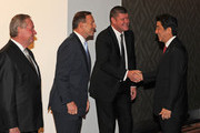 Japanese Prime Minister Shinzo Abe (R) is greeted by James Packer (2R), Australian Prime Minister Tony Abbott (2L) and Western Australia Premier Colin Barnett as he arrives to witness the signing of a statement on July 9, 2014 in Perth, Australia. Abe is visiting New Zealand, Australia and Papua New Guinea to hold talks on bilateral and international issues.