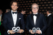 (L-R) Henry Cavill and Herbert Groenemeyer pose with their awards on stage during the GQ Men of the Year Award show at Komische Oper on November 08, 2018 in Berlin, Germany.