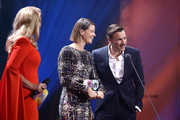 Barbara Schoeneberger and award winners Jessica Schwarz and Florian David Fitz on stage during the GQ Men of the Year Award show at Komische Oper on November 07, 2019 in Berlin, Germany.