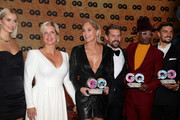 Laudator Lena Gercke, CEO Conde Nast Germany Jessica Peppel-Schulz, award winner Sharon Stone, laudator Klaas Heufer-Umlauf, and award winners Billy Porter and  Mariano Di Vaio pose during the GQ Men of the Year Award show at Komische Oper on November 07, 2019 in Berlin, Germany.