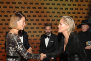 Award winners Jessica Schwarz and Sharon Stone shake hands during the GQ Men of the Year Award show at Komische Oper on November 07, 2019 in Berlin, Germany.
