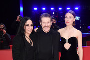 "(L-R) Giada Colagrande, Willem Dafoe and Cristina Chiriac pose at the ""Siberia"" premiere during the 70th Berlinale International Film Festival Berlin at Berlinale Palace on February 24, 2020 in Berlin, Germany."