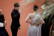 """(L-R) Gaspard Ulliel, Adele Exarchopoulos and Justine Triet attend the screening of """"Sibyl"""" during the 72nd annual Cannes Film Festival on May 24, 2019 in Cannes, France."""