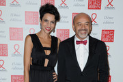 (L-R) Farida Khelfa and Christian Louboutin pose as they arrive to attend the Sidaction Gala Dinner 2013 at Pavillon d'Armenonville on January 24, 2013 in Paris, France.