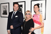 "(EXCLUSIVE COVERAGE) (L-R) Saks Fifth Avenue CMO Mark Briggs, Nancy Sinatra and Amanda Erlinger attend the ""Sinatra"" book launch event at Saks Fifth Avenue on July 23, 2015 in New York City."