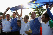 (L-R) Lee Westwood, Ross Fisher, Graeme McDowell, Luke Donald, Peter Hanson and Francesco Molinari of Europe celebrate their victory in the 2010 Ryder Cup at the Celtic Manor Resort on October 4, 2010 in Newport, Wales.