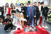 Sir Lucian Grainge (C) is accompanied by guests including Tori Kelly, Hailee Steinfeld, Justin Bieber, Lionel Ritchie, Sam Smith and Shawn Mendes as he is honored with a star on the Hollywood Walk of Fame on January 23, 2020 in Hollywood, California.