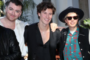 (L-R) Sam Smith, Shawn Mendes and Beck pose as Sir Lucian Grainge is honored with a Star on the Hollywood Walk of Fame on January 23, 2020 in Hollywood, California.