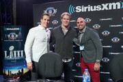 (L-R) Brady Quinn, Greg Olsen and Bruce Gradkowski attend SiriusXM at Super Bowl LIII Radio Row on January 31, 2019 in Atlanta, Georgia.