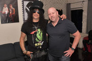 Slash (L) and Erik Luftglass backstage at SiriusXM Presents Slash Ft. Myles Kennedy and The Conspirators at Whisky a Go Go on September 11, 2018 in West Hollywood, California.