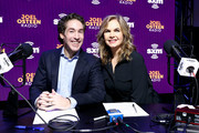 (L-R) SiriusXM host Joel Osteen and SiriusXM host Victoria Osteen take photos during day 3 of SiriusXM at Super Bowl LIV on January 31, 2020 in Miami, Florida.