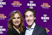 SiriusXM host Victoria Osteen and SiriusXM host Joel Osteen take photos during day 3 of SiriusXM at Super Bowl LIV on January 31, 2020 in Miami, Florida.
