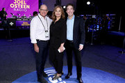 SiriusXM President and Chief Content Officer Scott Greenstein, SiriusXM host Victoria Osteen and SiriusXM host Joel Osteen take photos during day 3 of SiriusXM at Super Bowl LIV on January 31, 2020 in Miami, Florida.