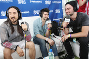 """Steve Aoki (L) and Dyro (R) are interviewed by Kramer (C) at SiriusXM's """"UMF Radio"""" at the SiriusXM Music Lounge at W South Beach on March 27, 2014 in Miami Beach, Florida."""