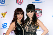 Singer Lisa Marie (L) and model Claire Sinclair arrive at the sixth annual Fighters Only World Mixed Martial Arts Awards at The Palazzo Las Vegas on February 7, 2014 in Las Vegas, Nevada.
