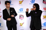 Television personality Nick Simmons (L) and his father, Kiss singer/bassist Gene Simmons, joke around as they arrive at the sixth annual Fighters Only World Mixed Martial Arts Awards at The Palazzo Las Vegas on February 7, 2014 in Las Vegas, Nevada.