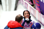 Shelley Rudman (R) of Great Britain reacts after competing a run during the Women's Skeleton on Day 7 of the Sochi 2014 Winter Olympics at Sliding Center Sanki on February 14, 2014 in Sochi, Russia.