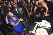 Shante Broadus (L) and rapper Snoop Dogg attend Snoop Dogg's 40th Birthday Party at The Rolling Stone Lounge on October 18, 2011 in Hollywood, California.