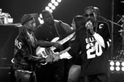 This image was processed using digital filters.)  Producer/Recording artist Pharrell Williams (L) and rapper Snoop Dogg perform onstage during Snoop Dogg Live on the Honda Stage at iHeartRadio Theater on May 11, 2015 in Burbank, California.