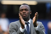Usain Bolt of Soccer Aid World XI acknowledges the fans prior to the Soccer Aid for UNICEF 2019 match between England and the Soccer Aid World XI at Stamford Bridge on June 16, 2019 in London, England.