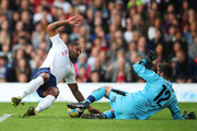 Glen Johnson of England and Julio Cesar of Soccer Aid World XI battle for the ball during the Soccer Aid for UNICEF 2019 match between England and the Soccer Aid World XI at Stamford Bridge on June 16, 2019 in London, England.